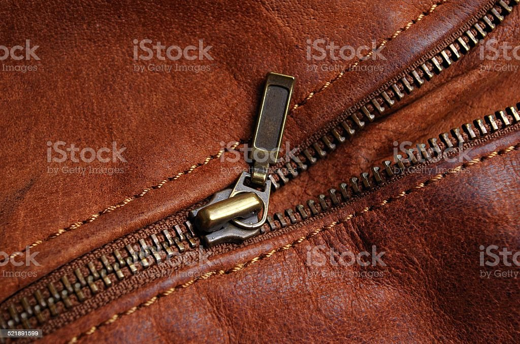 Zipper of a brown leather jacket stock photo