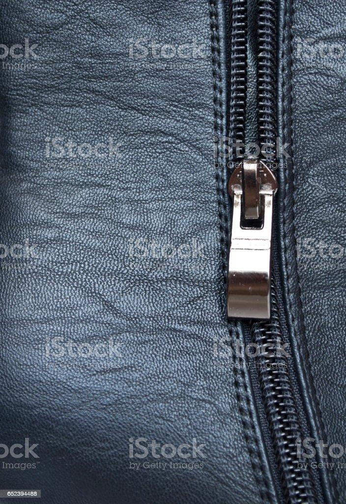Zipper on black leather detail stock photo