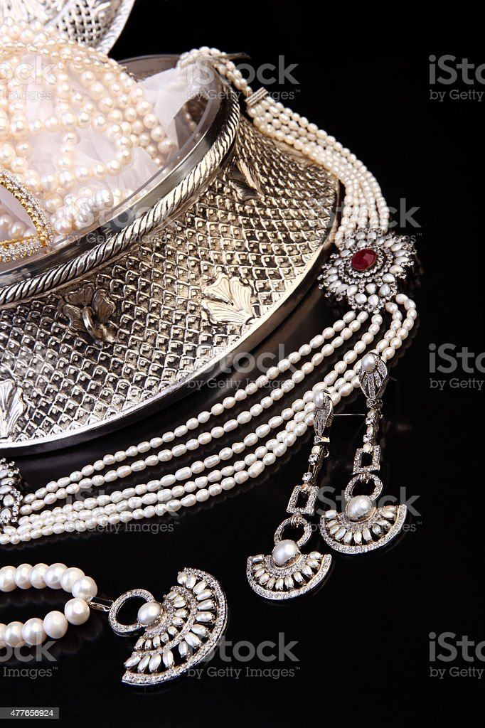 Zircon, Pearl and Silver Jewelry in Indian style handcrafted jewelry-chest stock photo