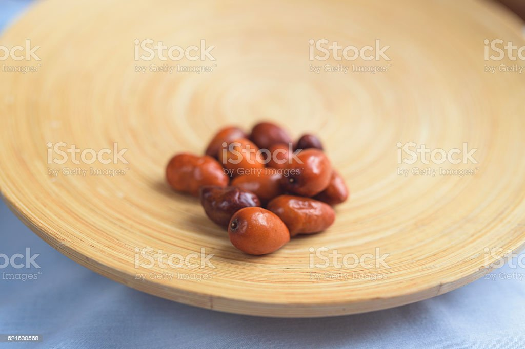 Ziziphus Jujuba On A Wooden Plate stock photo