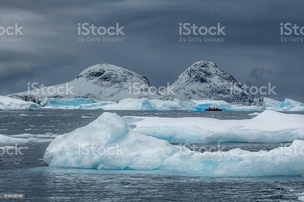 Zodiac among the Antaractic Icebergs stock photo
