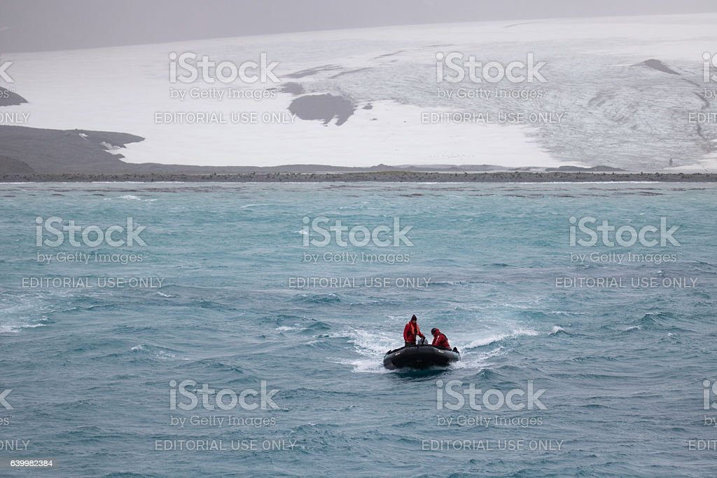 Zodiac returning from glacier stock photo