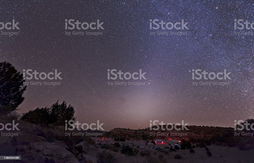 Zodiacal Light over star party royalty-free stock photo