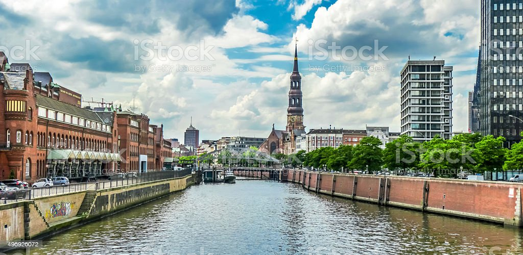 Zollkanal with St. Catherine's Church in warehouse district, Hamburg, Germany stock photo