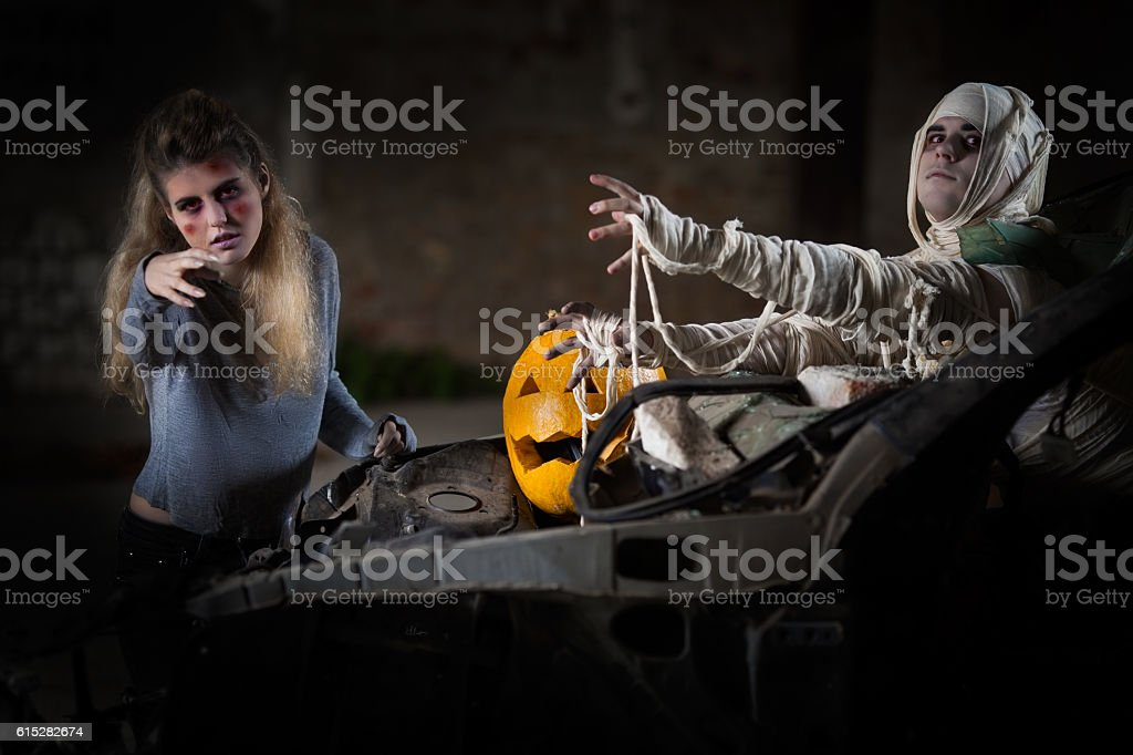 Zombie and Mummy Attack on a Jack O' Lantern stock photo