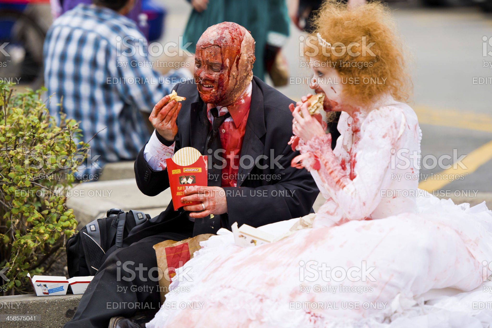 Zombie Bride and Groom Eating McDonalds royalty-free stock photo