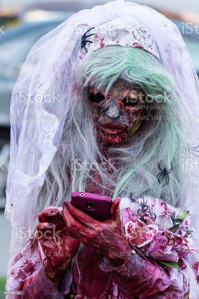 Zombie Bride checks her phone stock photo