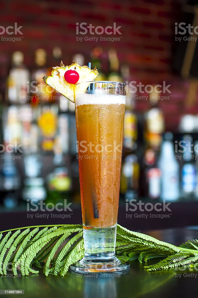 Zombie cocktail near on the  classic black bar table stock photo