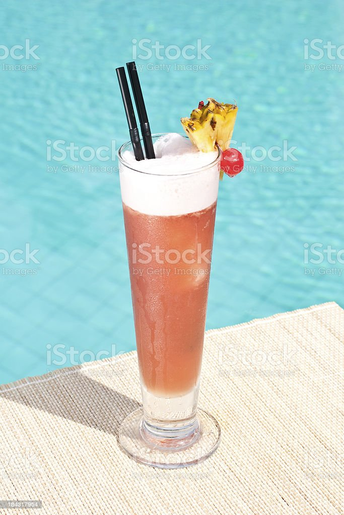 Zombie cocktail near waterpool on the mat stock photo