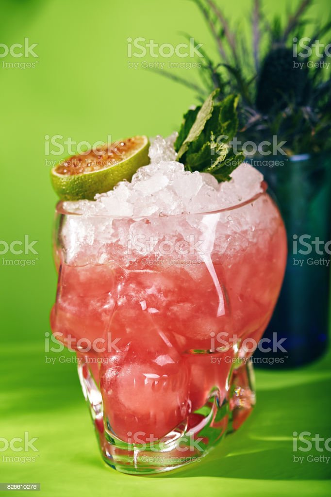 Zombie Cocktail on Green Background stock photo