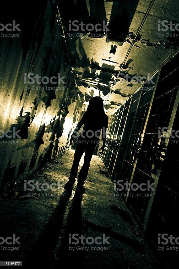 Zombie Creature in long dark corridor stock photo