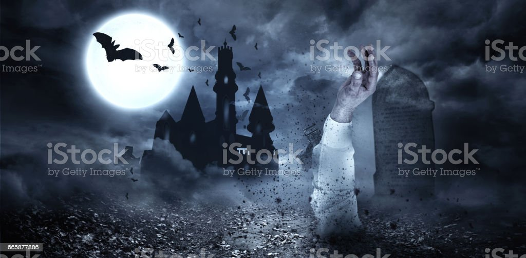 Zombie hand bursting from the grave royalty-free stock photo