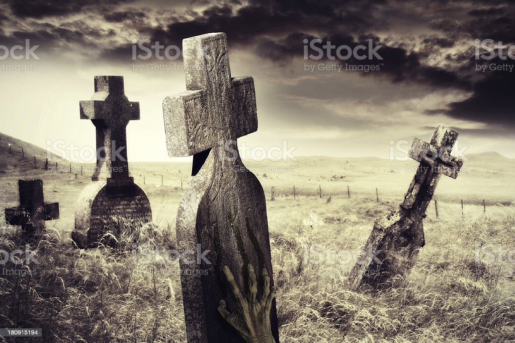 Zombie hand scratching marks on tombstone stock photo