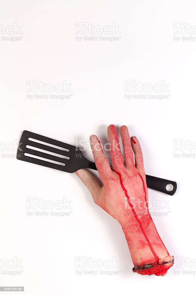 Zombie Hand with spatula ,flipper ,spade of frying pan stock photo