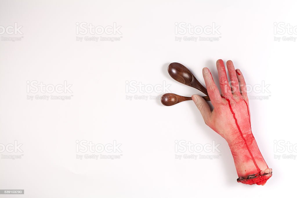 Zombie Hand with Wooden spoon on white background stock photo