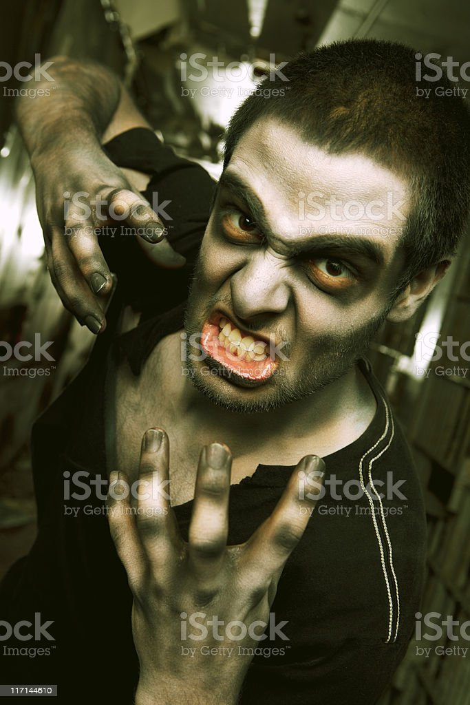 Zombie Living Dead Attack in Jail Cell Hallway stock photo