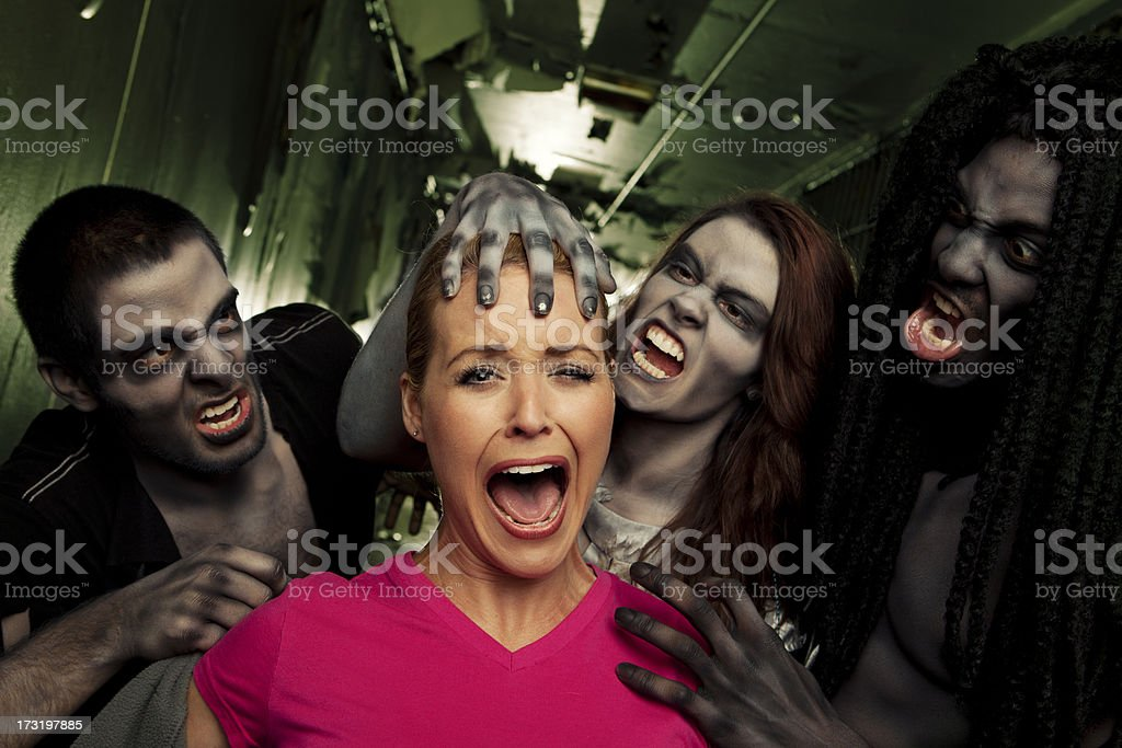 Zombie Living Dead Attack Victim in Jail Cell Hallway royalty-free stock photo