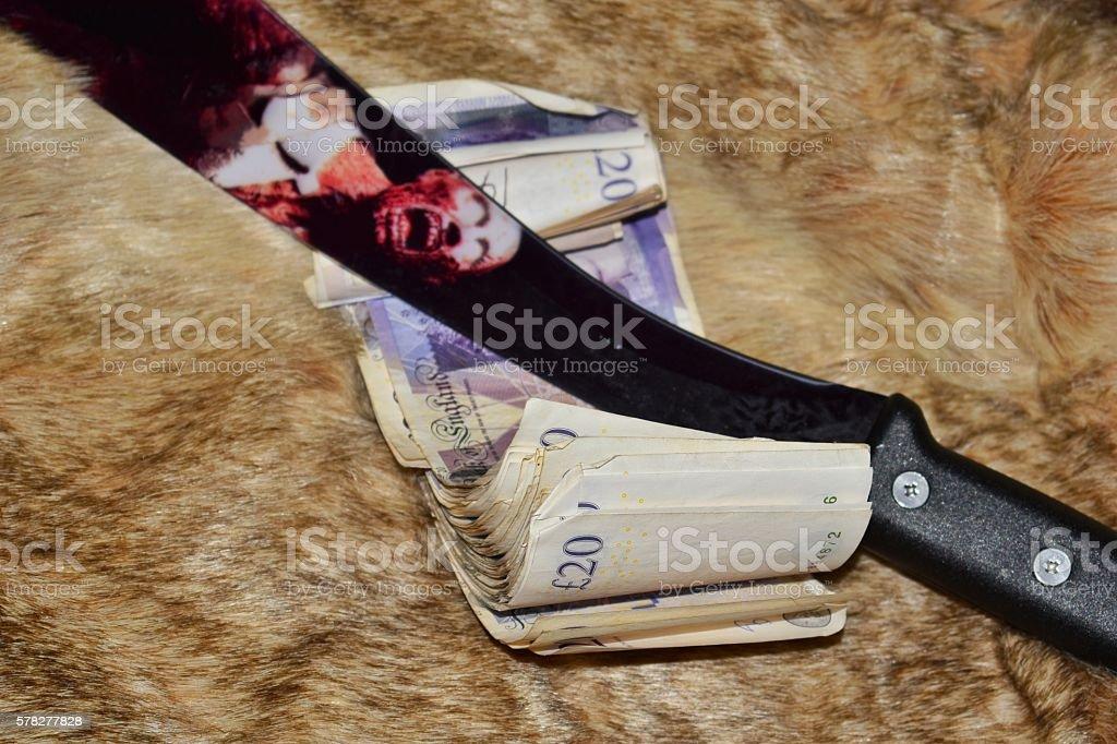 Zombie Machete and a thousand pounds on a fur stock photo