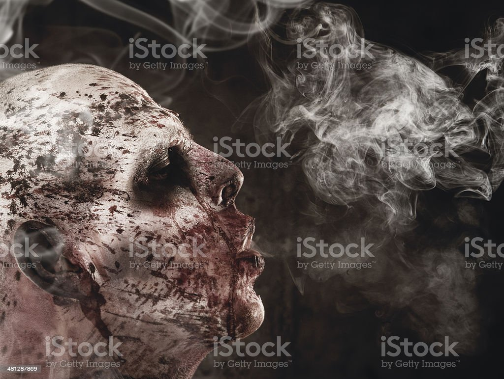 Zombie smoking stock photo