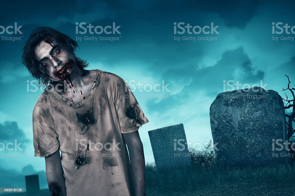 Zombie walking with creepy expression stock photo