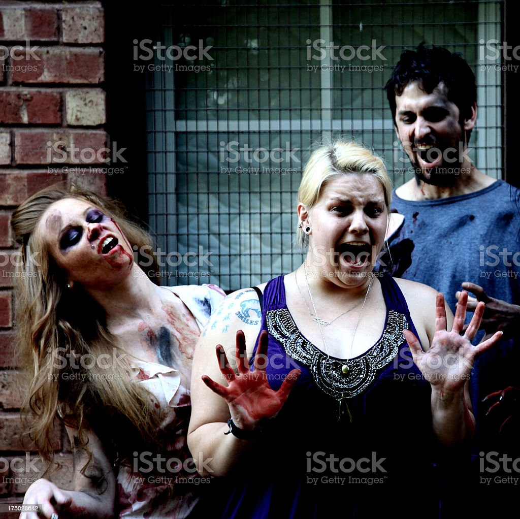 Zombies attacking royalty-free stock photo