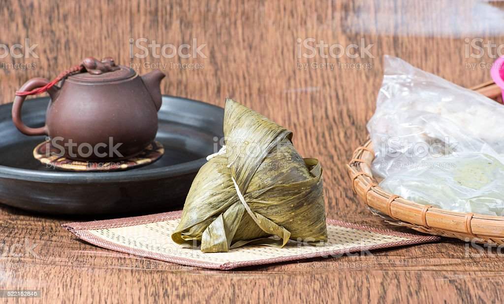 Zongzi on wooden table with cup and Kway stock photo