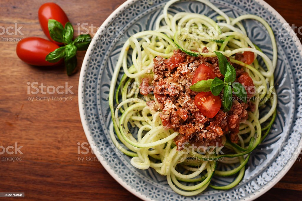 Zoodles with vegan bolognese and yeast flakes stock photo