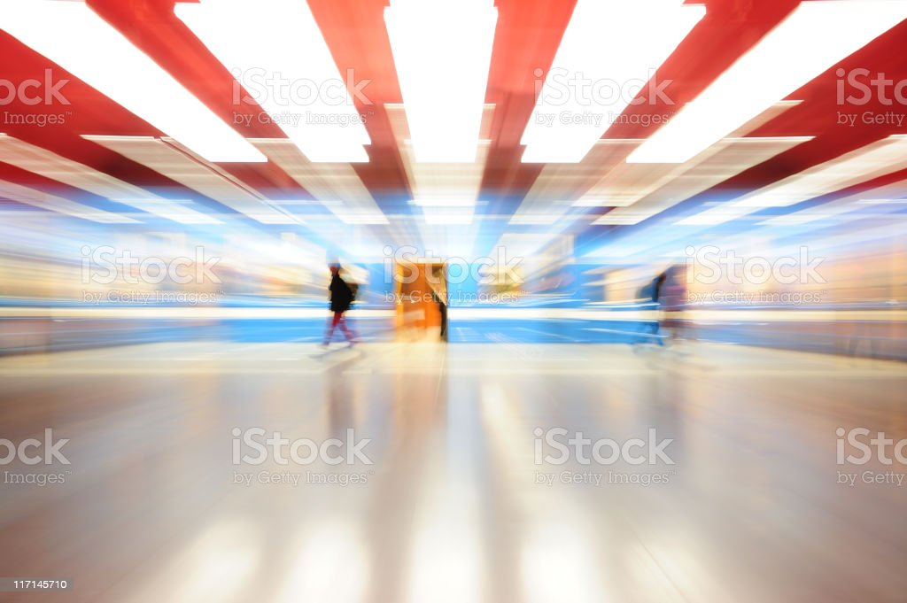 Zoom blurred brightly lit colorful subway train seen from side royalty-free stock photo