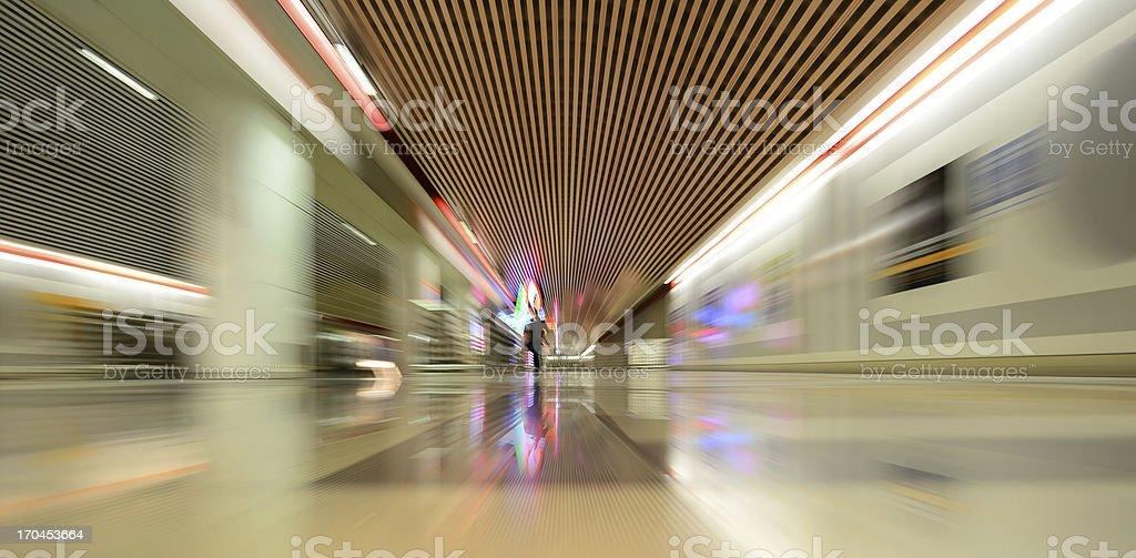 Zoom blurred subway train station stock photo