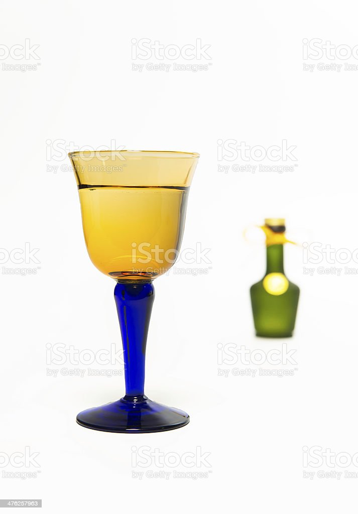 Zoom in whisky glass with blur green bottle royalty-free stock photo