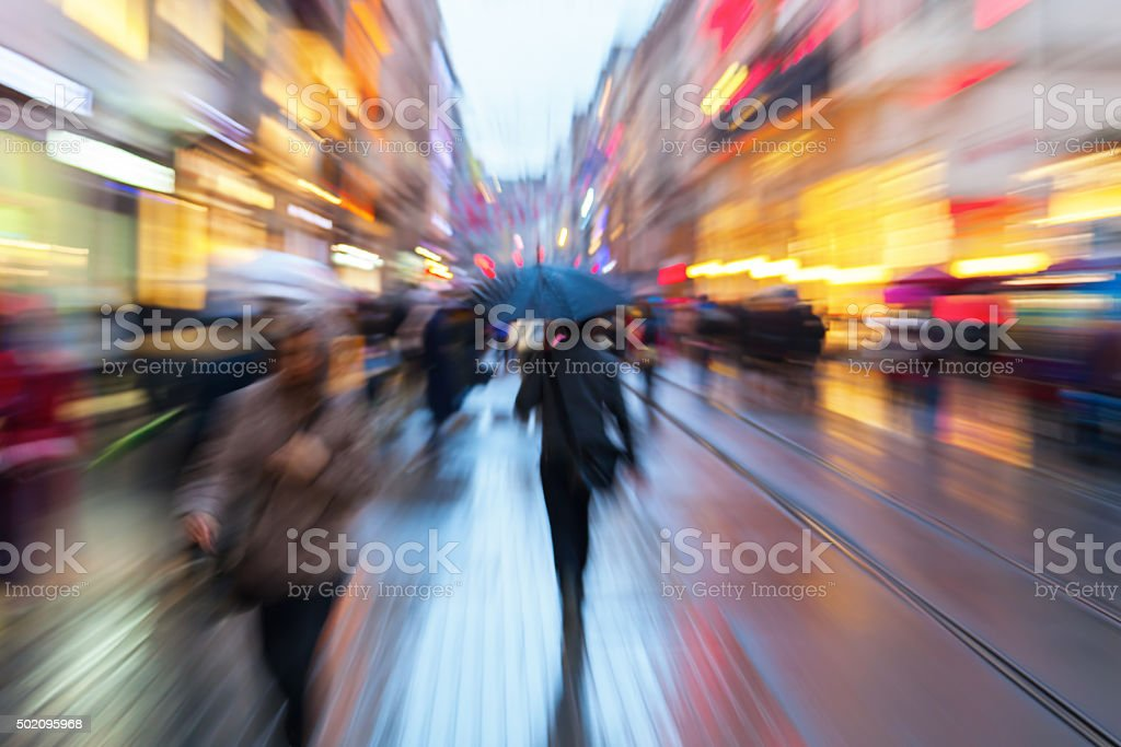 zoom picture of people in the rainy city stock photo