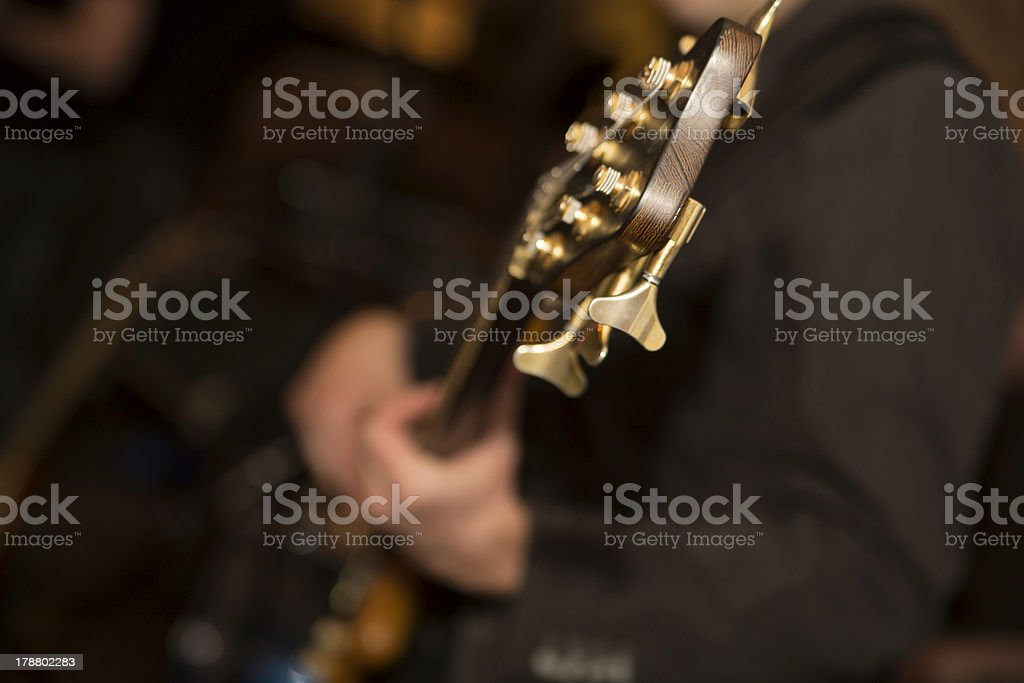 Zoomed guitar neck head with six energized strings royalty-free stock photo