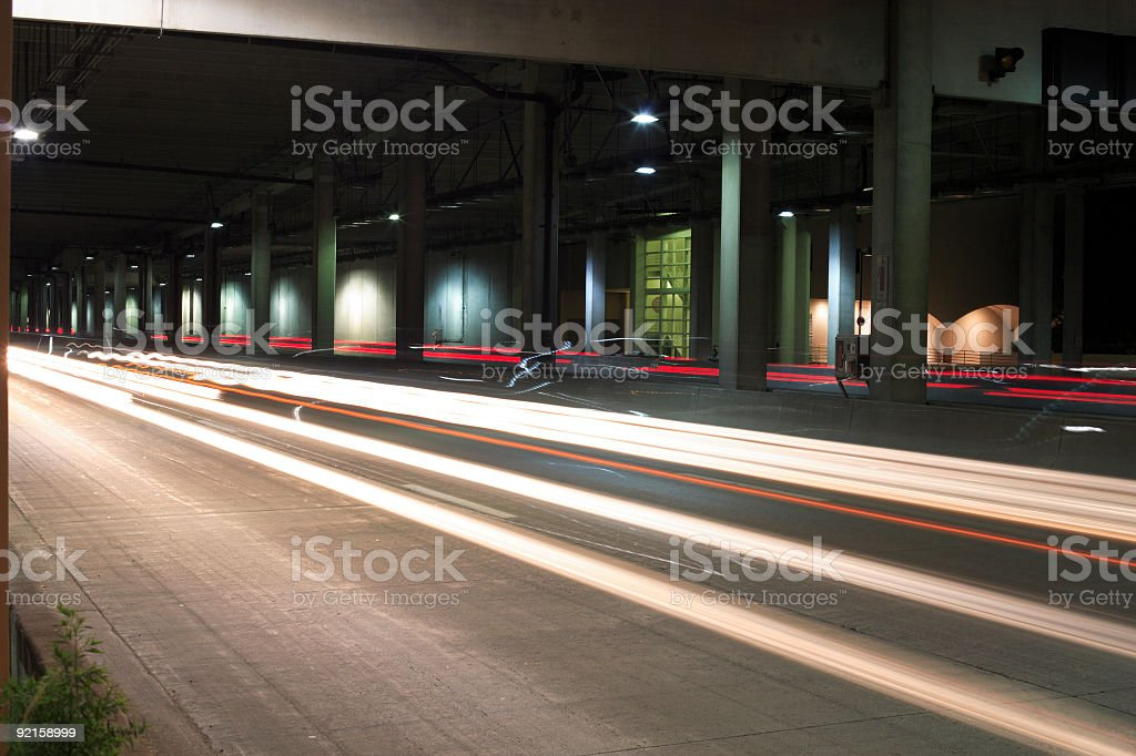 Zooming cars (under the bridge) stock photo