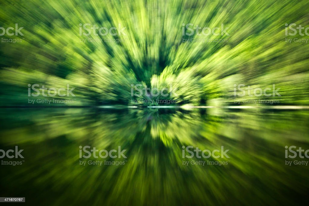 zooming effect in mountain forest lake stock photo