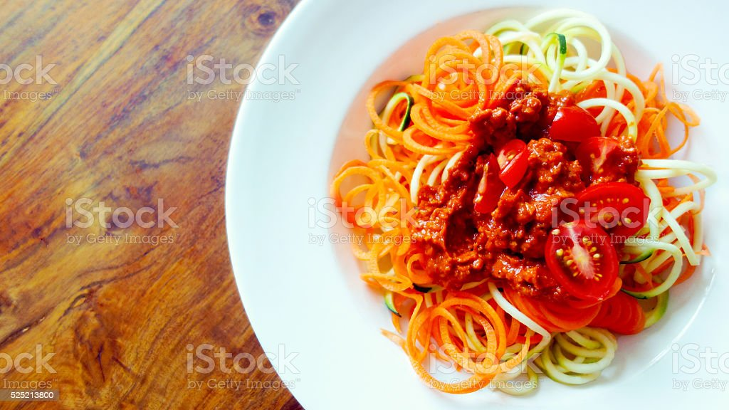 Zucchini and carrot pasta with vegan bolognese made of tofu stock photo