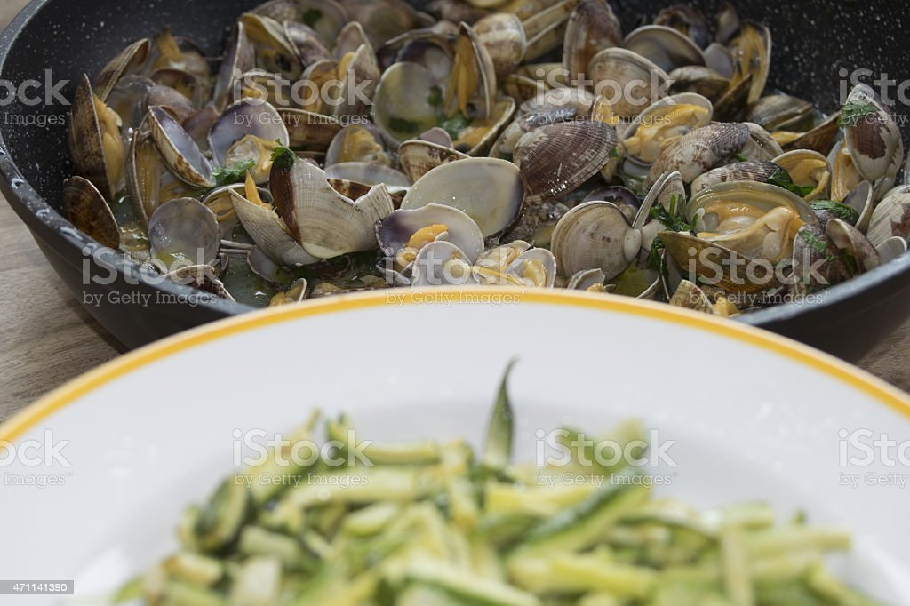 zucchini and clams stock photo