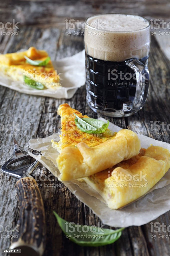 Zucchini and lards quiche with dark beer stock photo
