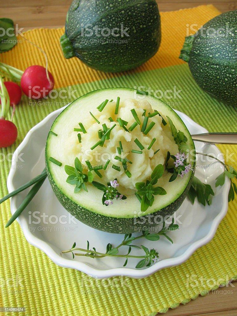 Zucchini ball stuffed with mashed potatoes stock photo