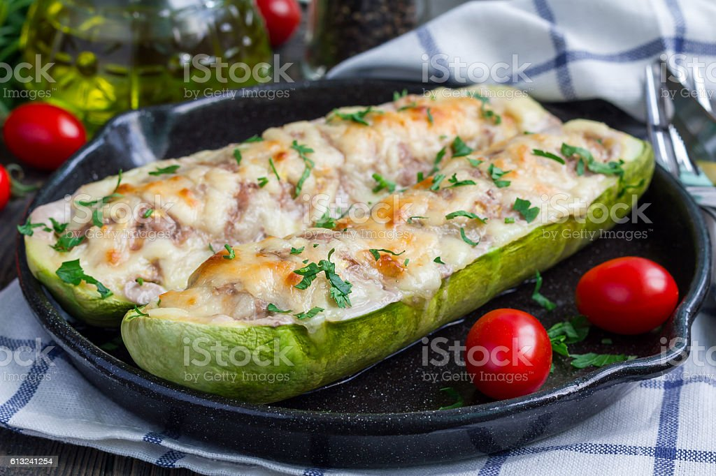 Zucchini boats stuffed with ground meet and topped with cheese stock photo