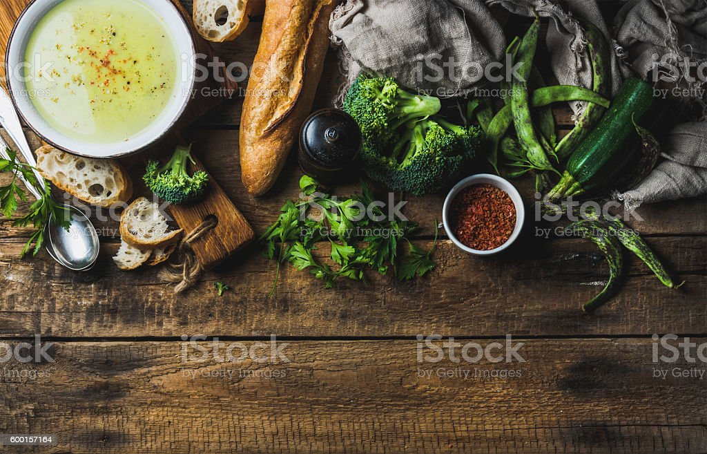 Zucchini, broccoli and green beans cream soup in bowl stock photo