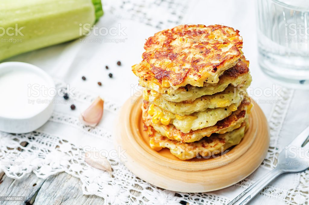 zucchini corn fritters stock photo