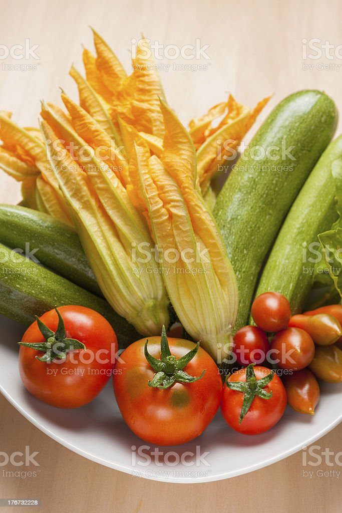 Zucchini flowers and tomatoes royalty-free stock photo