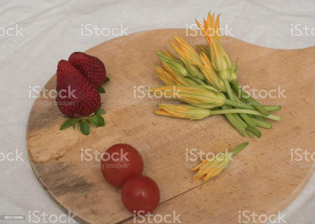Zucchini flowers, tomatoes and sreawberries ingredients of Smart Diet stock photo