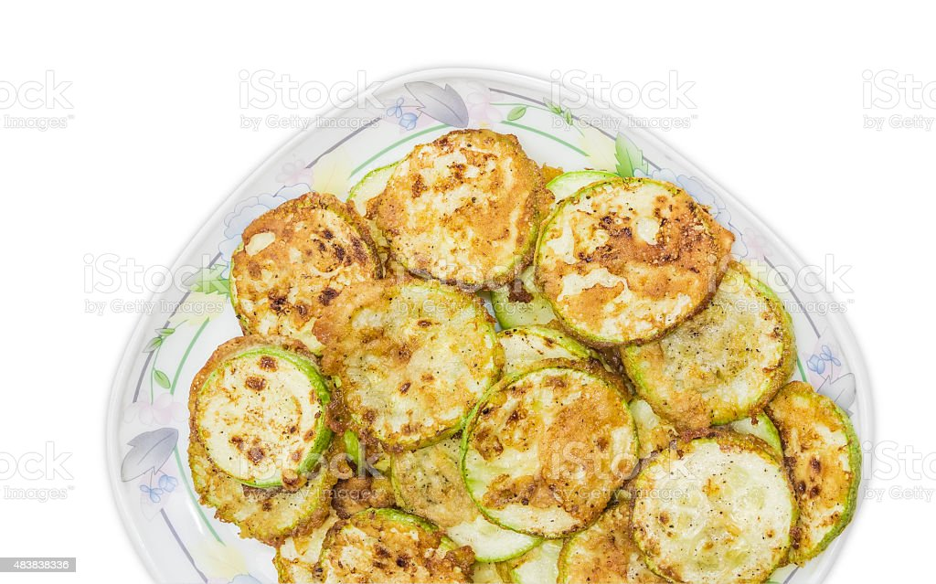 Zucchini, fried in batter on dish on a light background stock photo