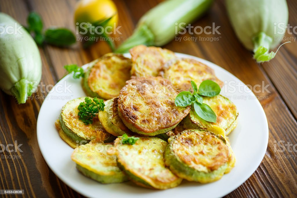 zucchini fried in batter stock photo