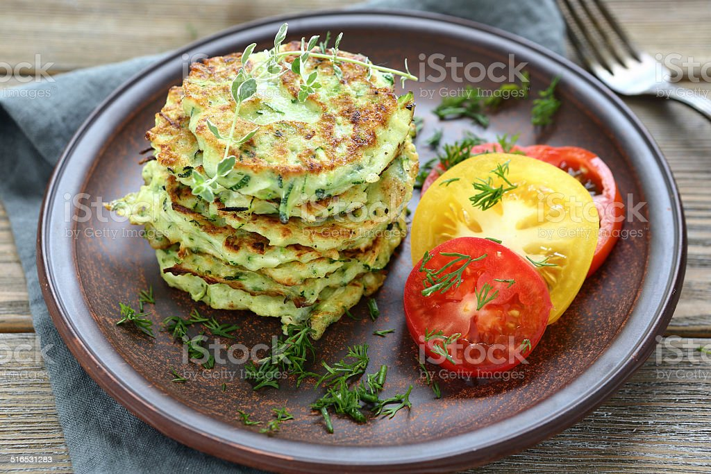 zucchini fritters with dill stock photo