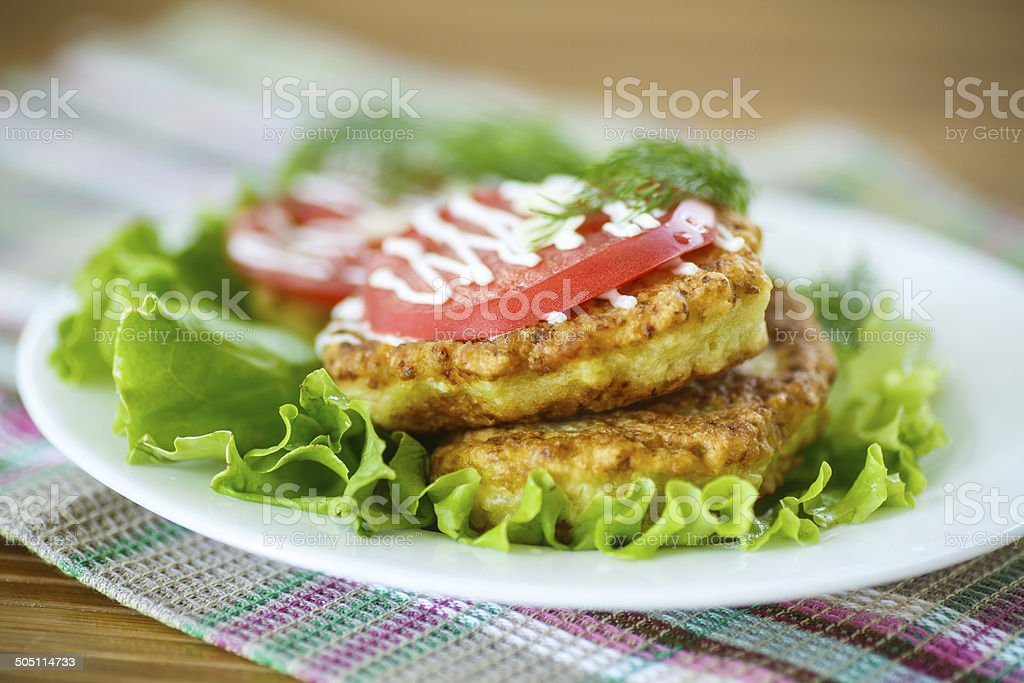 zucchini fritters with tomatoes royalty-free stock photo