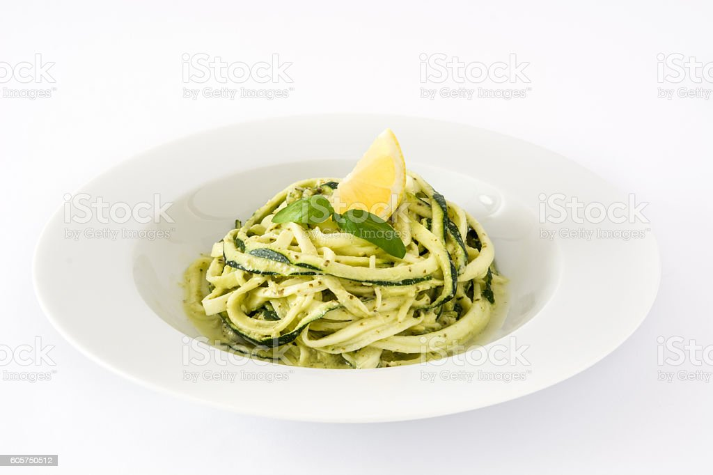 Zucchini noodles with pesto sauce stock photo
