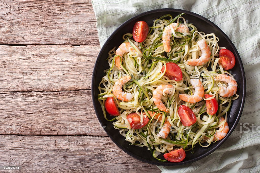 zucchini pasta with shrimp and tomato closeup. Horizontal top vi stock photo