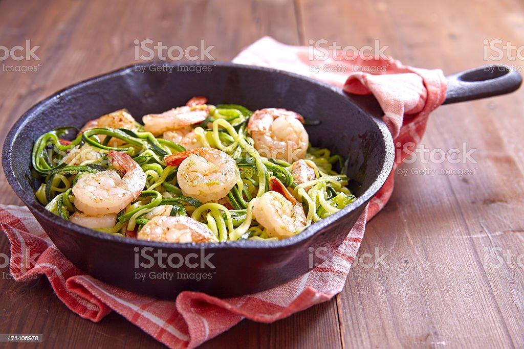 Zucchini spaghetti with shrimp stock photo